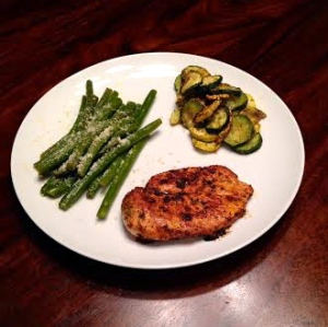 blackened organic chicken breast, yellow squash, zucchini, and steamed green beans.